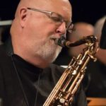 Tom Scott plays the saxophone